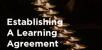 establishing a learning agreement photo with candles