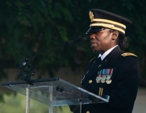 U.S. Army Chaplain (Capt.) Azande Sasa gives the invocation during the opening ceremony for the National Association of Landscape Professionals' 19th annual Renewal and Remembrance at Arlington National Cemetery, July 16, 2015. Over 400 volunteers worked on 200 of the cemetery's 624 acres. Some of the work done was mulching, pruning, aerating, planting, liming and applying gypsum. (U.S. Army photo by Rachel Larue/released)